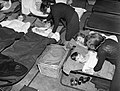 Homeless and orphaned children settle down to sleep in the air raid shelter at John Keble Church, Mill Hill, London during the Blitz in 1940. D1439.jpg