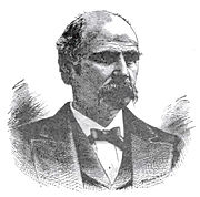 An engraving of a man with a mustache in a suit and tie