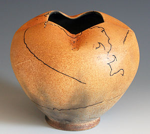 Raku ware - Pot with an example of horsehair raku technique. The vessel was taken out of the kiln at 732 Celsius and horsehair applied on, which burned into it.