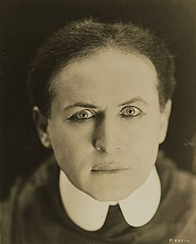 A close-up of Houdini staring to the camera
