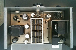 HP200A - Insides of the Hewlett-Packard HP200A. The light bulb repurposed as a positive temperature coefficient resistor is to the right of the upper section of variable capacitor which is itself the large structure in center.