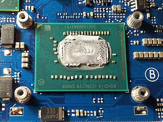 Ivy Bridge (microarchitecture) - A uncovered Intel Core i5-3210M (BGA) inside of a laptop, an Ivy Bridge CPU