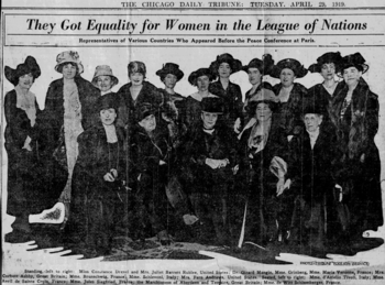 Group photograph of hatted women with five seated on the front row and eleven standing behind