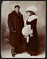 Jack Johnson and his wife Etta, full-length portrait, standing, wearing winter coats LCCN2011649815.jpg