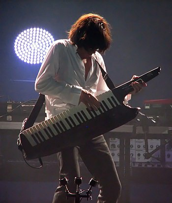 English: Jean Michel Jarre playing an AX-Synth
