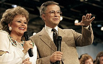 The PTL Club - Hosts Tammy Faye and Jim Bakker during a PTL Club broadcast in 1986
