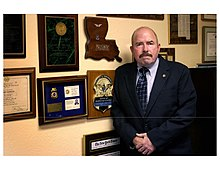 Joe Gutheinz Office & Badge.jpg
