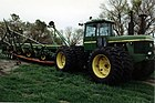 John Deere 8630 with machinery on trailer.jpg