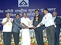 K.V. Thomas presenting the Rajiv Gandhi National Quality award in the category of Small Scale Manufacturing Industry to Technocrat Connectivity Systems.jpg