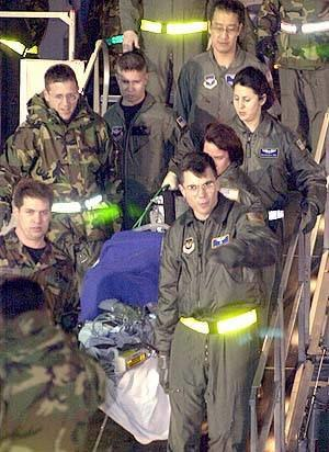Kathleen Kenna - Members of Ramstein's 86th Aeromedical Airlift Squadron carry Canadian reporter Kathleen Kenna, injured in Afghanistan, from a C-9 Nightingale of the 75th Airlift Squadron to a waiting ambulance upon arrival at Ramstein AB, Germany, March 6.