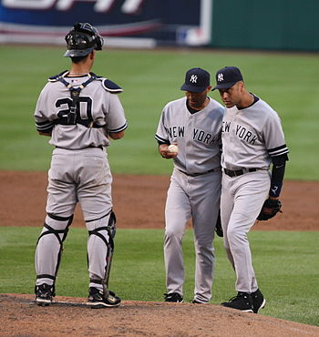 English: Jorge Posada (#20, left) with Mariano...