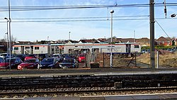 Kilwinning railway station. View of old goods sidings and a Tamper. North Ayrshire, Scotland.jpg
