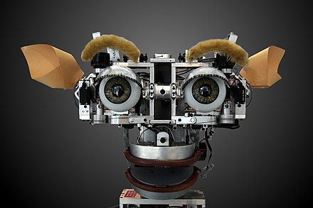 Robotic Kismet can produce a range of facial expressions. Kismet-IMG 6007-gradient.jpg
