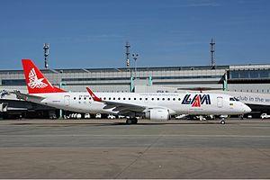LAM Mozambique Airlines - A LAM Mozambique Airlines Embraer 190 at OR Tambo International Airport. (2009)