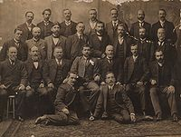 Group photograph of all Federal Labour Party MPs elected at the inaugural 1901 election, including Chris Watson, Andrew Fisher, Hughes, and Frank Tudor.