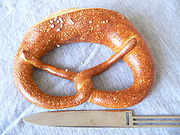 German Brezel, with knife