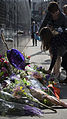 Leaving flowers for Prince at First Avenue in Minneapolis (25961157864).jpg