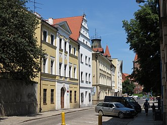 Legnica - One of the preserved streets in Legnica's Old Town with the Castle in the background