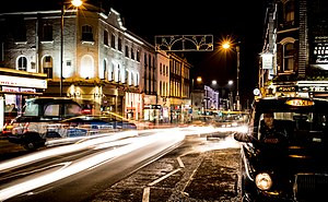 Night photography - A London taxi turning outside the railway station at Sutton, London