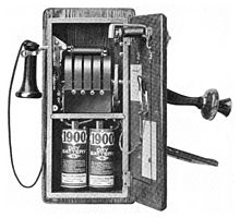 1917 wall telephone, open to show magneto and local battery