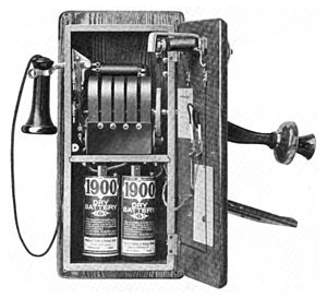 History of the telephone - 1917 wall telephone, open to show magneto and local battery