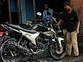 Man Grooming Steed - Tansen - Nepal (13773129374).jpg