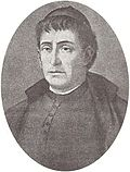 Black and white oval portrait of a priest. The image is focused on his face, looking to the left.