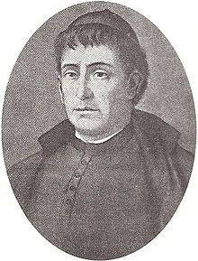 Retrat oval en blanc i negre d'un sacerdot. La imatge se centra en la seva cara, mirant cap a l'esquerra.