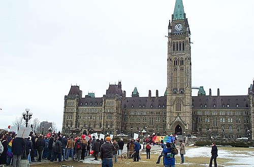 "The ""March of Hearts"" rally for same-sex marriage equality under the Charter in 2004. March of Hearts crowd on Parliament Hill 2004.jpg"