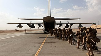 Task Force Leatherneck - HELMAND PROVINCE, Afghanistan - Marines and sailors with Marine Expeditionary Brigade – Afghanistan load onto a KC-130 aircraft on the Camp Bastion flightline, Oct. 27, 2014. The Marine Corps ended its mission in Helmand province, Afghanistan, the day prior and all Marines, sailors and service members from the United Kingdom withdrew from southwestern Afghanistan. Photo by: SSgt John Jackson