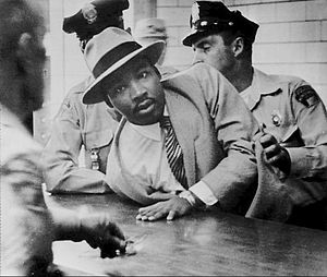 Charles Moore (photographer) - Photo of Martin King being arrested for loitering while present at a colleague's court case.