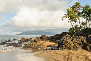 Maui - Volcanic rocks protrude on a Maui beach