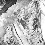 McBride and Riggs Glaciers, tidewater glacier terminus with icebergs in water, August 22, 1965 (GLACIERS 5651).jpg