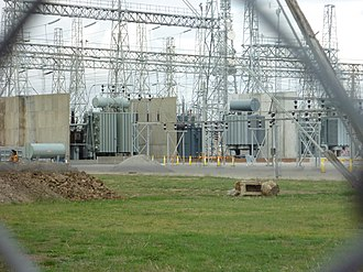 Electrical substation - A 50 Hz electrical substation in Melbourne, Australia. This is showing three of the five 220 kV/66 kV transformers, as well as high-voltage transformer fire barriers, each with a capacity of 150 MVA. This substation is constructed using steel lattice structures to support strain bus wires and apparatus.