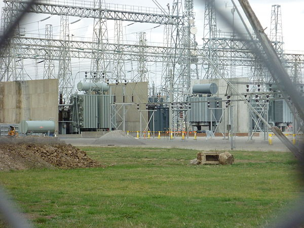 A 50 Hz electrical substation in Melbourne, Australia. This is showing three of the five 220 kV/66 kV transformers, as well as high-voltage transformer fire barriers, each with a capacity of 150 MVA. This substation is constructed using steel lattice structures to support strain bus wires and apparatus. Melbourne Terminal Station.JPG