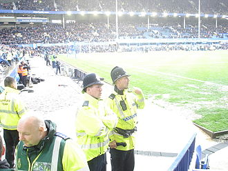 Law enforcement in the United Kingdom - An officer of the Metropolitan Police with an officer of Merseyside Police during a Football match between Everton and West Ham at Goodison Park