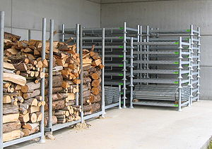Pallet - A metal pallet with removable beams, in this case for firewood