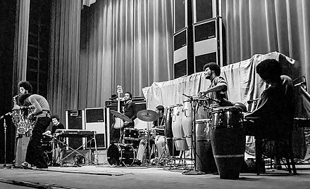 "Davis' septet in November 1971; left to right: Gary Bartz, Davis, Keith Jarrett, Michael Henderson, Leon ""Ndugu"" Chancler, James Mtume, and Don Alias Miles Davis-140916-0018-105WPa.jpg"