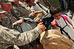 Mississippi Army National Guard soldiers donate backpacks and school supplies to Afghan children DVIDS424606.jpg