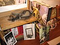 Mixed-Media Photo-desk arrangement with self-portrait and two portraits of Linda janakos.jpg
