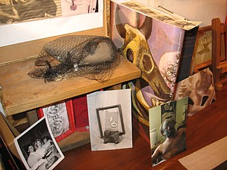 Doren Robbins - Image: Mixed Media Photo desk arrangement with self portrait and two portraits of Linda janakos