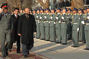 Afghan Peace Jirga 2010 - Interior Minister Mohammad Hanif Atmar passing by Afghan National Police honor guards shortly before he stepped down after the NCPJ