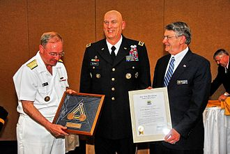 Raymond T. Odierno - Rear Admiral James (Phil) Wisecup and Rear Admiral (Ret) Glenn E. Whisler, Jr. present General Odierno with the Naval War College Distinguished Graduate Leadership Award.