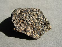 A speckled rock with black and white grains