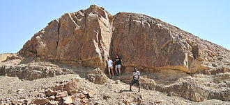 Stock (geology) - A stock of nordmarkite (quartz-alkali syenite) of Triassic age, in the Gevanim Valley, Makhtesh Ramon, southern Israel.