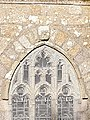 Norman carved head on St Maddern Church, Madron Cornwall.jpg