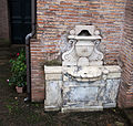 Outside wall of the Lateran Baptistery, wall fountain.jpg