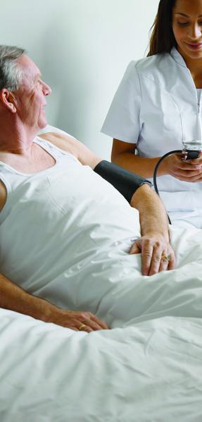 File:Patient having blood pressure taken by nurse.tiff