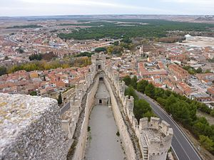 Peñafiel, Spain - Wing of the Peñafiel Castle overlooking the town of Peñafiel and the Duero valley lined with pinewoods