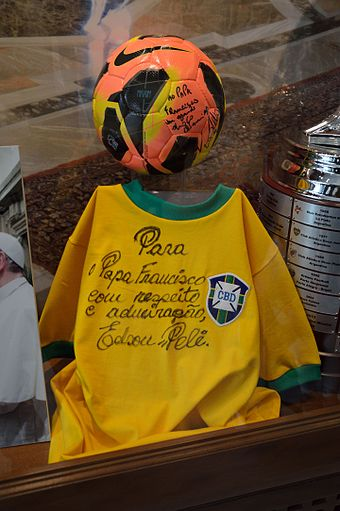 A practicing Catholic, Pele donated a signed jersey to Pope Francis. Accompanied with a signed football from Ronaldo, it is located in one of the Vatican Museums. Pele's jersey donated to Pope Francis.JPG